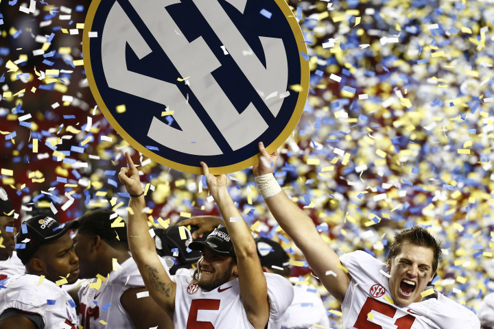Alabama Crimson Tide Carson Tinker and Jeremy Shelley celebrate after beating the Georgia Bulldogs during the NCAA SEC college football championship in Atlanta