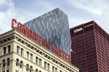 The sign atop the historic Congress Plaza Hotel joins more modern architecture along Michigan Ave. in Chicago.