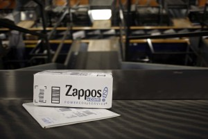 A package from Zappos.com moves down a conveyor belt during the afternoon sort at the United Parcel Service Inc. (UPS) Worldport facility in Louisville, Kentucky, U.S., on Tuesday, April 21, 2015. United Parcel Service Inc. is scheduled to release quarterly earnings results on April 28. Photographer: Luke Sharrett/Bloomberg via Getty Images