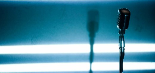 A microphone backlit on a stage (Photo by Universal Images Group via Getty Images)