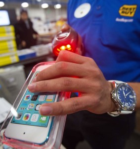 A salesperson scans an iPod Touch at the Best Buy store during the Black Friday doorbuster sale that started on Thursday November 27, 2014 at 5:00pm in Fairfax, Virginia.   Black Friday is a day of deep commercial discounts and frenzied shopping which takes place each year after the Thursday Thanksgiving holiday in the United States.        AFP Photo/Paul J. Richards        (Photo credit should read PAUL J. RICHARDS/AFP/Getty Images)