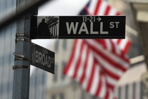 A Wall Street road sign is pictured near the New York Stock Exchange (NYSE) building on October 16, 2014 in New York. US stocks dropped sharply in early trade Thursday, following international markets downward as anxiety over global growth continued to prompt selling. About 30 minutes into trade, the Dow Jones Industrial Average stood at 16,062.34, down 79.40 points (0.49 percent). AFP PHOTO/Jewel Samad        (Photo credit should read JEWEL SAMAD/AFP/Getty Images)