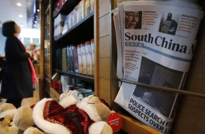 A copy of South China Morning Post is displayed on a magazine rack at a coffee shop in Hong Kong, Friday, Dec. 11, 2015. Chinese e-commerce giant Alibaba says it's buying Hong Kong's leading English language newspaper, the South China Morning Post. Alibaba Group said late Friday it signed a deal with publisher SCMP Group to buy the Post and the company's other media assets, which also include magazines, outdoor advertising and digital media. (AP Photo/Kin Cheung)