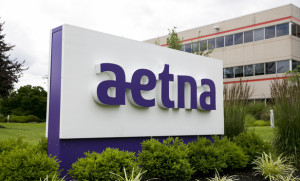 A logo sign outside of a facility occupied by Aetna, Inc., in Blue Bell, Pennsylvania on June 28, 2015. Photo by Kristoffer Tripplaar *** Please Use Credit from Credit Field ***