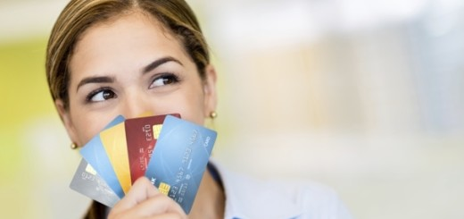 Business woman with credit cards thinking how to spend the money