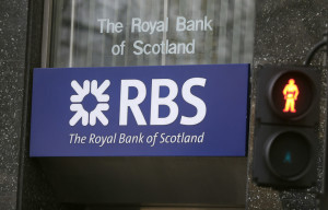 A logo of a branch of the Royal Bank of Scotland in London, Friday, Feb. 26, 2016.  Royal Bank of Scotland, which is around 73 percent owned by the taxpayers, racked up its eighth year in a row of annual losses, and Shares plunged 9 percent in London on the news. (AP Photo/Frank Augstein)